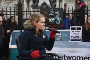 Ellen Murray speaking to a crowd at Belfast City Hall while sitting in her wheelchair