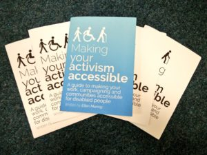 Several printed copies of Making Your Activism Accessible arranged in a fan layout.