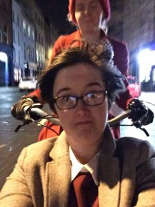 Lyra and I on a bike ride together in 2017, with her in the front seat of my cargobike, riding through Belfast in the wet.